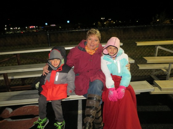 Hanging at a football game withmy two youngest grandkids.